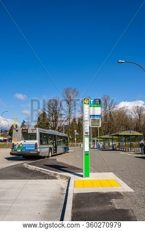 N. Vancouver, Canada - Apr 7, 2020: Virtually Deserted Public Transit Bus Exchange, Mid-morning, Dur