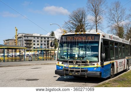 N. Vancouver, Canada - Apr 7, 2020: Public Transit Bus Displaying Message For Passengers To Enter Th