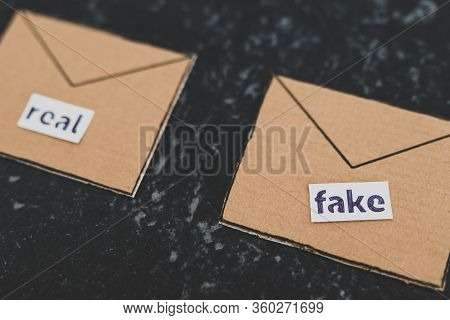 Fake Emails Or Online Scams, Email Envelop Icons With Real Vs Fake Labels On Them