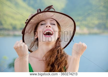 Lucky Girl. Happy Young Woman Happy Exults Pumping Fists Ecstatic Isolated Green Wall Background. Ce