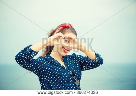 Love. Closeup Portrait Smiling Happy Young Woman Making Heart Sign, Symbol With Hands Isolated Sea S