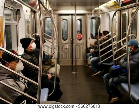 New York, United States, Usa March 24, 2020: People With Mask In New York Subway Station During Coro