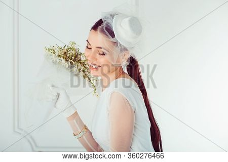 Happy Retro Bride. Closeup Portrait Smiling Happy Young Woman Girl Looking Down Wards Isolated White