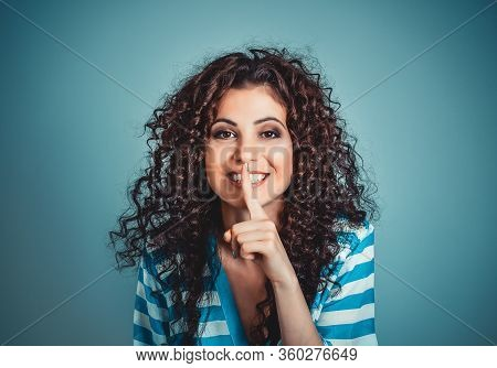 Woman Wide Eyed Asking For Silence Secrecy With Finger On Lips Hush Hand Gesture Blue Isolated Backg