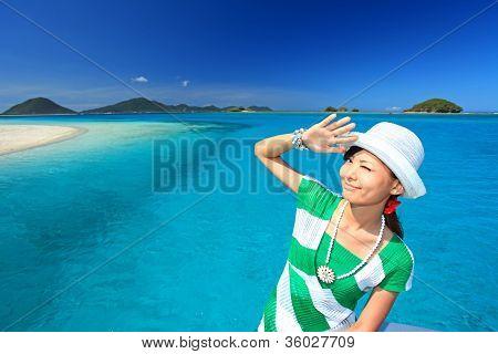 The woman at the beautiful sea in Okinawa