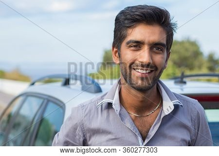 Happy Man Driver Smiling Standing By His New Car Isolated Outside Nature Sea Background. Handsome Yo