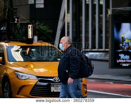 New York, United States, Usa March 26, 2020: Iconic Picture Of Overweight Man With Mask In Front Of