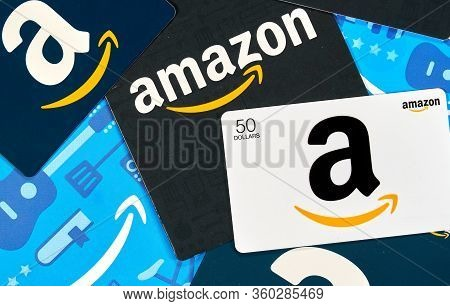 Montreal, Canada - April 6, 2020: Different Amazon Gift Cards. Amazon Is A Titan Of E-commerce, Paym