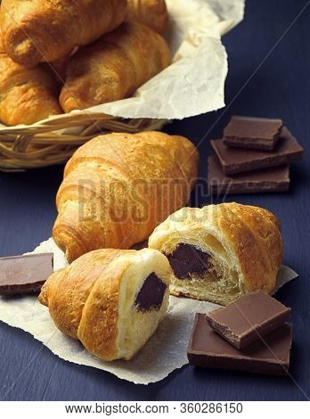 French Croissant. Freshly Baked With Chocolate On Dark Background. Tasty Croissants . Morning Breakf