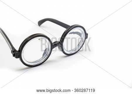 Funny. Isolate On White Background. Round Black Rimmed Glasses With Thick Lenses. Of Poor Vision.