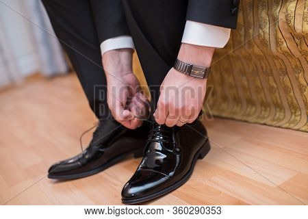 Closeup View Of Male Hands Lacing Beautiful Elegant Shoes. Wedding Day. Groom Tie His Shoe . Man Wea
