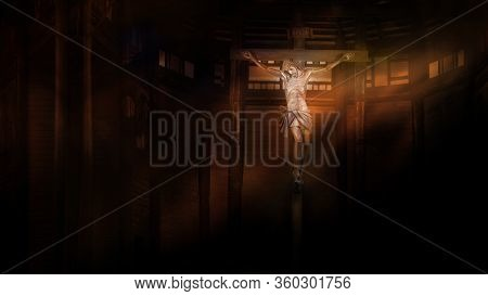 Crucifix, Jesus On The Cross In Church With Ray Of Light In The Darkness