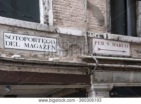 Venice, Italy - June 30, 2017: A View Of Dilapidated Facades Of The Houses With Signs. Text Means Fo