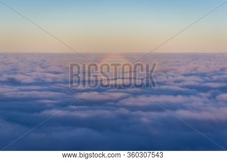 Optical Phenomenon Over Moring Clouds Seen From Plane Window