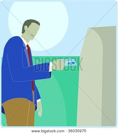 A Man Using An Instant Teller Machine