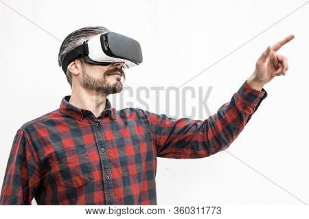 Focused Man In Vr Headset Moving Hand. Serious Bearded Man In Checkered Shirt Moving With Hand And U