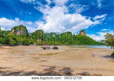 Panoramic View Of East Railay Beach, Krabi Town, Thailand. Landscape With Tractor In Foreground And