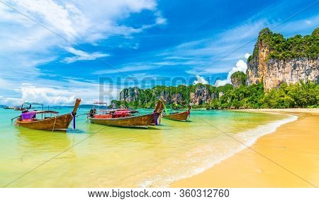 Beautiful View Of Long Tail Boats On Water In Railay Beach Bay, Thailand, Krabi Town. Famous Tourist