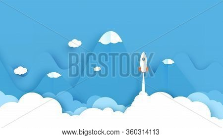 Wide Landscape With Rockets Glide Over The Mountains With Views Over The Beautiful Clouds On Blue Ba