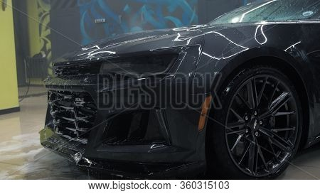 Tomsk, Russia - March 30, 2020: Chevrolet Camaro Zl1 The Exorcist With High Pressure Washer Side Vie