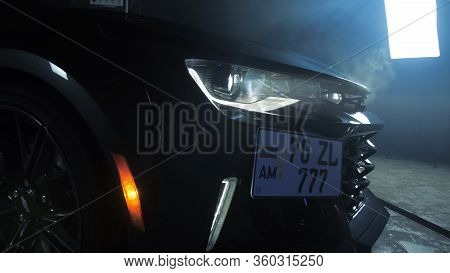 Tomsk, Russia - March 30, 2020: Chevrolet Camaro Zl1 The Exorcist Headlight Close-up Side View