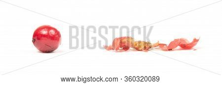 Whole Peper Next To A Crushed One - Red - Isolated On White