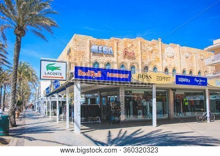 Mallorca, Spain - March 27 2018: El Arenal Promenade With The Famous Mega Park Club And Various Shop
