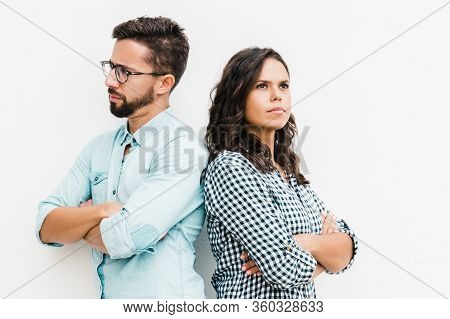 Annoyed Upset Couple Standing Back-to-back With Arms Crossed. Young Woman In Casual And Man In Glass