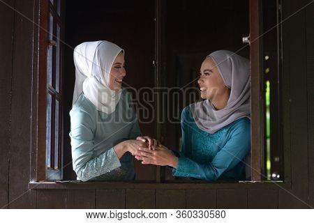 Asian Malay Muslim girls greetings during Hari Raya Aidilfitri. Malaysian people living lifestyle.