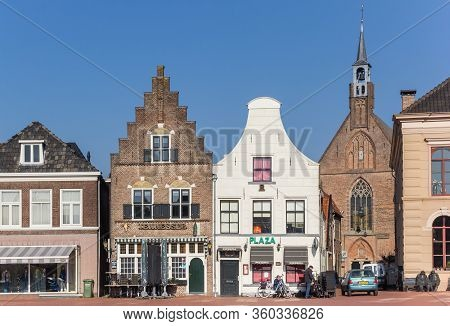Steenwijk, Netherlands - March 27, 2020: Clock Gable And Step Gable In Historic City Steenwijk, Neth