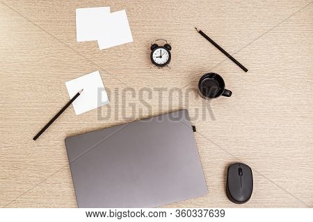 Working From Home. Laptop For Work And Clock For Control Time Every Day.  Workspace For Freelancer.