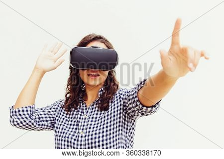 Student Girl Wearing Vr Goggles, Touching Air. Young Woman In Virtual Reality Headset Standing Isola