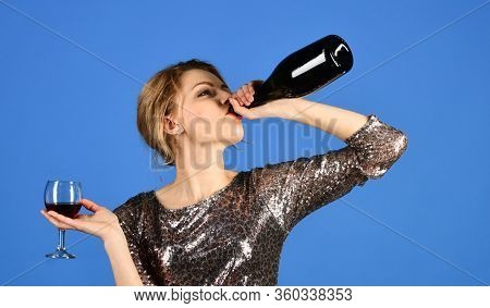 Friday Night Concept. Woman With Serious Face Drinks Expensive Cabernet