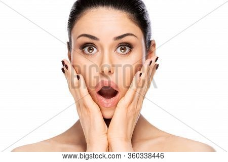 Beautiful Surprised Woman Face Portrait Close Up. Beauty Skin Care Concept. Isolated On White Backgr