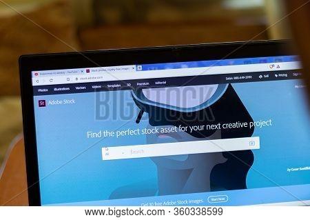 New York, Usa - 9 April 2020: Adobe Stock Website On Laptop Screen Close Up. Man Using Service On Di