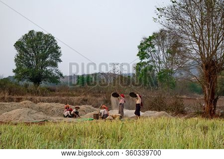 Bagan, Myanmar - February 23, 2016: Female Workers In Myanmar With The Tipical Colorful Scarves On T