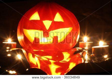 Halloween Pumpkin Jack-o-lantern Candle Lit, Isolated On Black Background