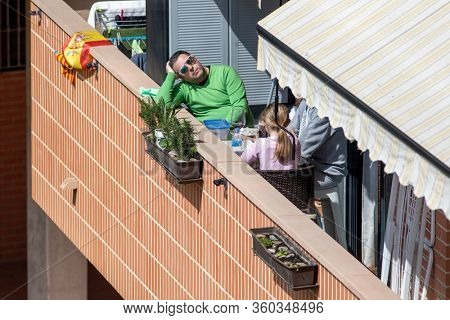 A family at mealtime in balcony after Spain imposed a lockdown to slow down the spread of the coronavirus disease in Valencia, Spain on April 5, 2020.