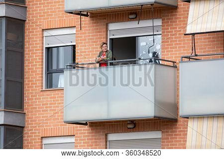 A woman in balcony after Spain imposed a lockdown to slow down the spread of the coronavirus disease in Valencia, Spain on April 5, 2020.