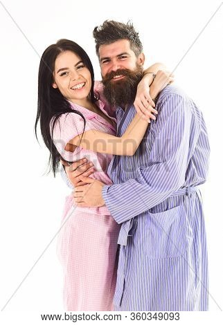 Couple In Love Hugging In Pajama, Bathrobe. Couple, Family On Smiling Faces Happy In Morning. Relati