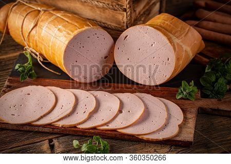 Processed Cold Meat Products On A Wooden Cutting Board