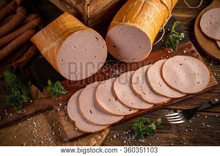 Deli Meat Slices On Vintage Wooden Background