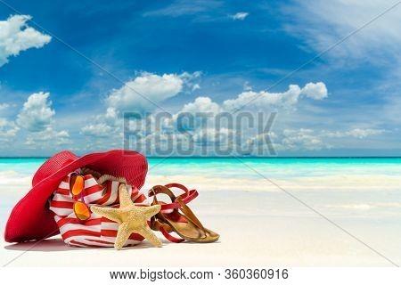 Beach bag hat and starfish at the tropical beach