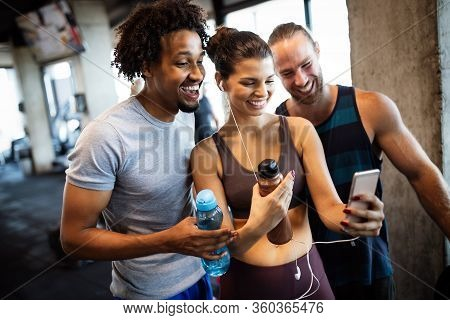 Group Of Sportive People In A Gym Taking Selfie. Concepts About Lifestyle And Sport In Fitness Club