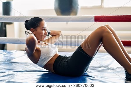 Fit Woman Doing Sit Up Exercise On Mat At Boxing Studio. Abs Workout Training For Abdominal Muscles.