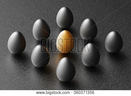 Black And Gold Eggs In Vertical Position On Plain Black Paper Background. Creative Minimalist Abstra