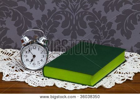 Retro Alarm Clock And Green Book