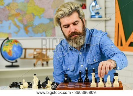 Moving Pieces On Chess Board. Man Hold Chess Piece. Concentrated Man Developing Chess Strategy. Play