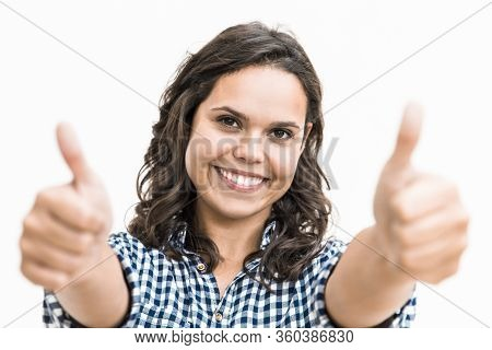 Satisfied Female Customer Making Like Gesture With Both Hands, Looking At Camera, Smiling. Young Wom