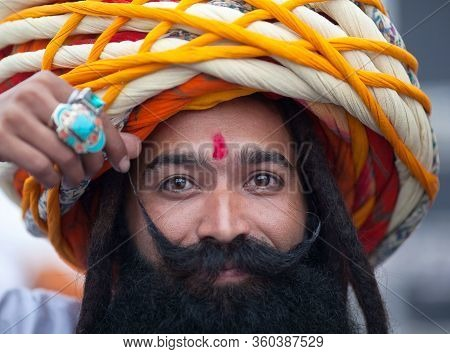 Bikaner, India - January 12, 2020: Rajasthani Smiling Man In Traditional Clothes With Beard And Long